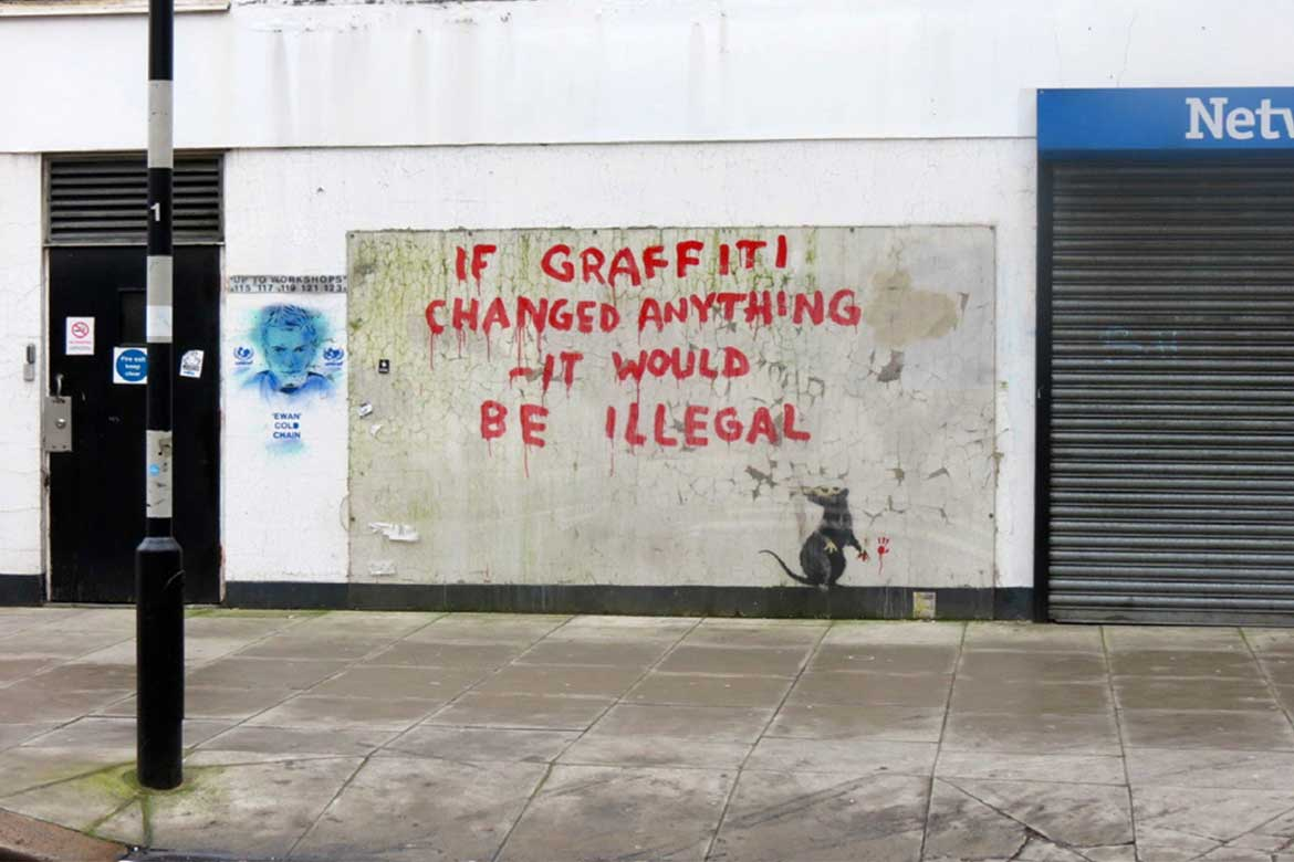 Street art by banksy that the London Borough of Camden Council opted to protect with plexiglass.