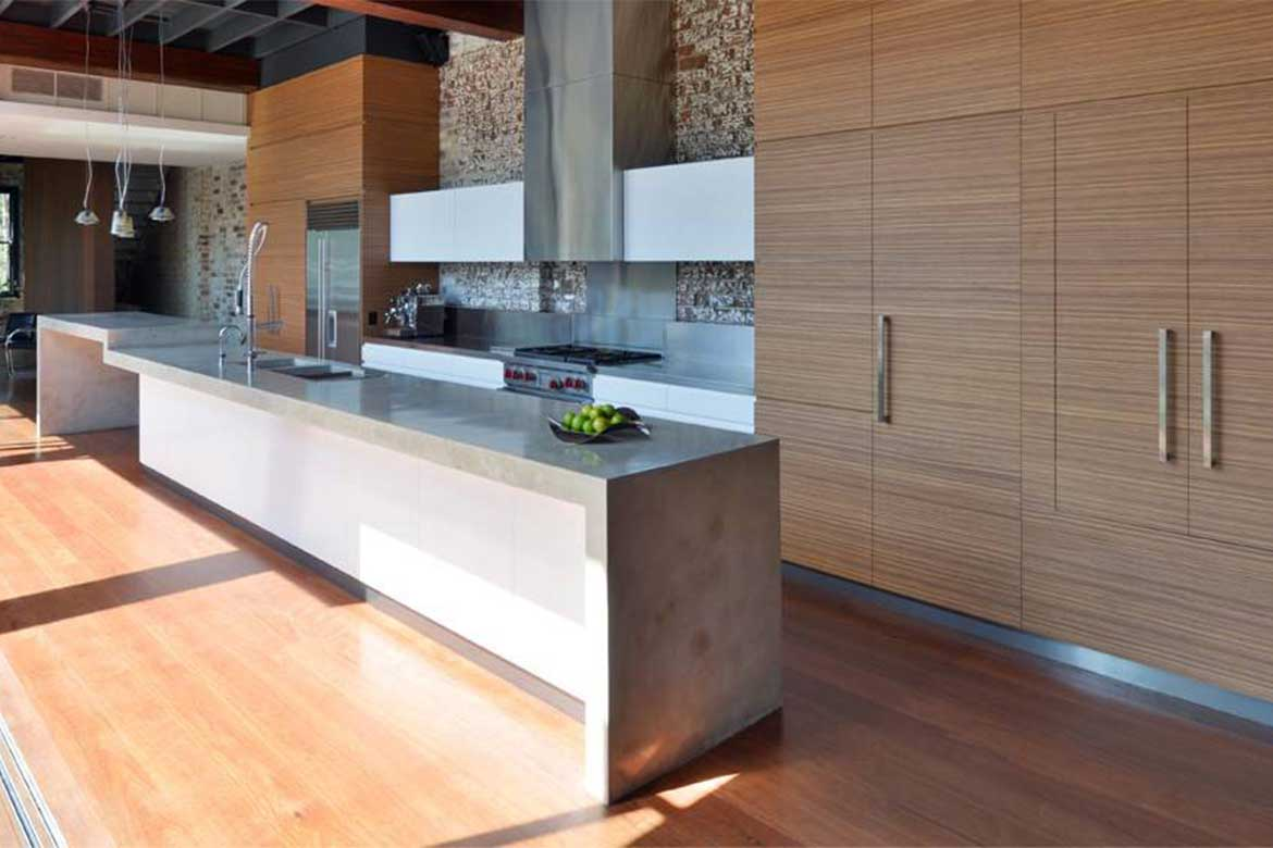 Exposed natural materials in kitchen space. Photo courtesy: flashconcrete.co.nz