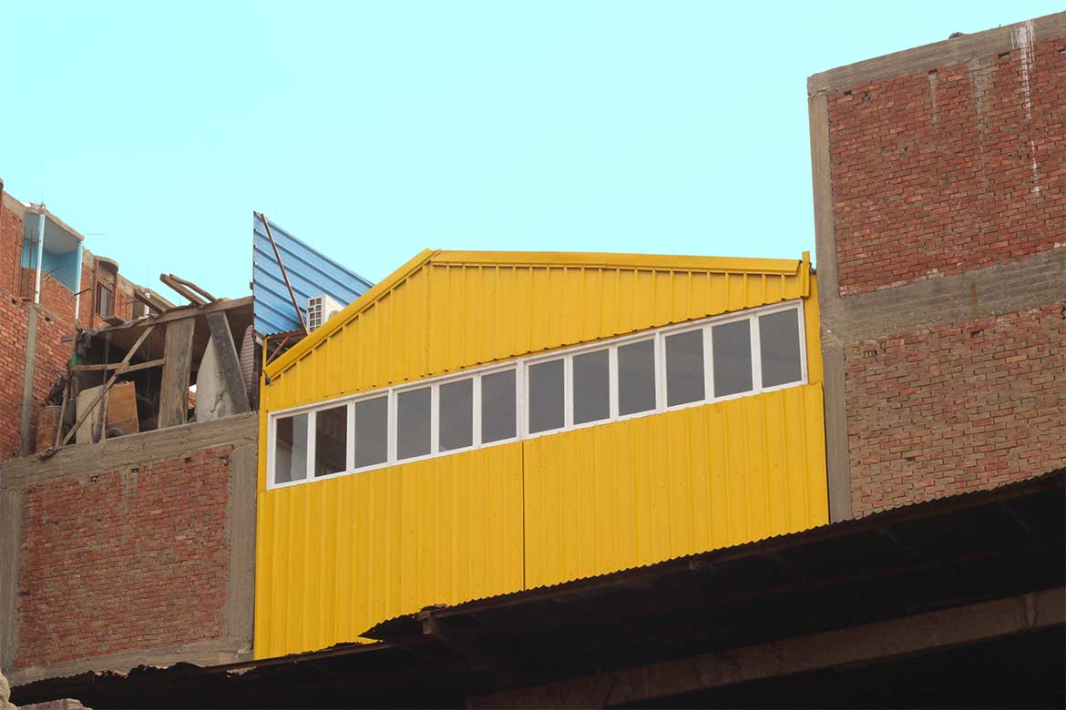 Yellow building contrasting with the red brick surrounding